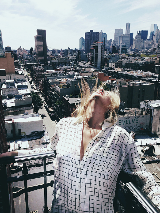 Camille Charriere is wearing a grid print shirt from Equipment