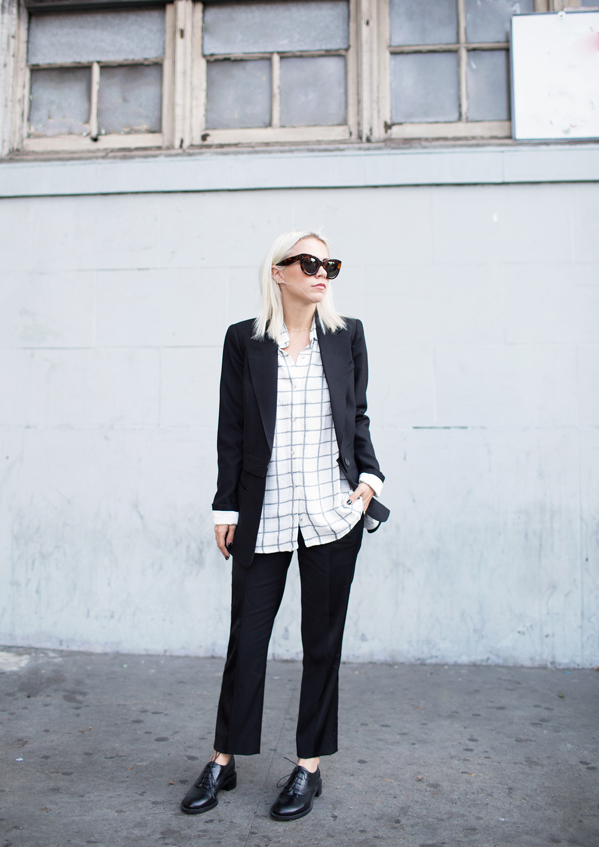The grid print trend is coming up big. Courtney Trop is wearing a grid print Oxford shirt from Myne