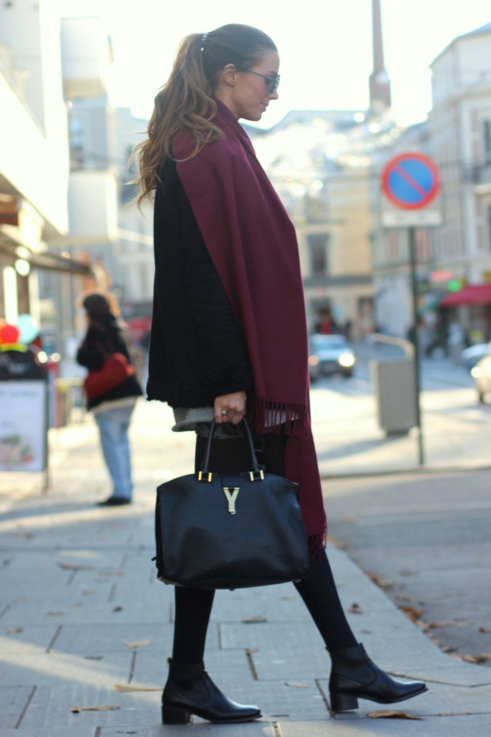 Benedichte is wearing a large burgundy scarf from Creative Collective