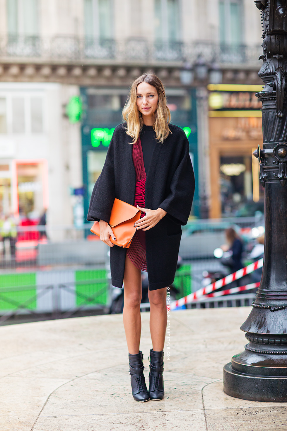 Candela, via Stockholm Street Style, is wearing a burgundy dress from Stella McCartney