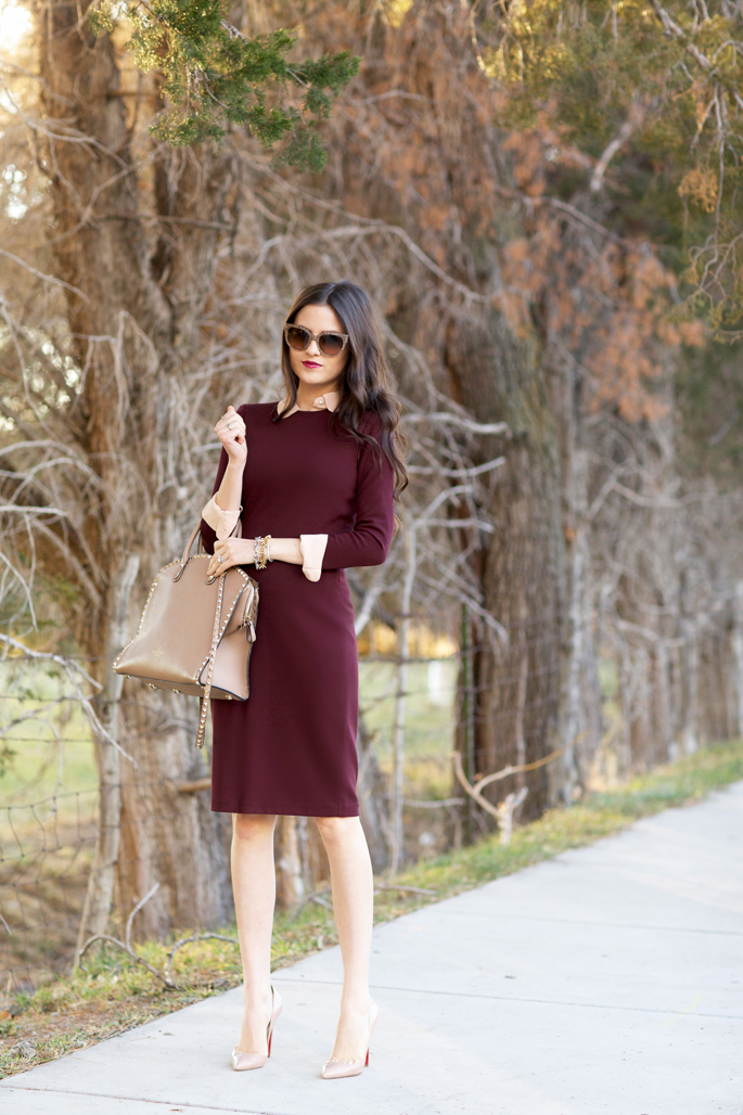 Rachel Parcell is wearing a burgundy three quarter sheath dress from Vince
