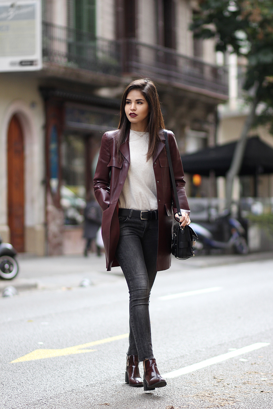 Adriana Gastélum is wearing a burgundy leather jacket and boots from Zara