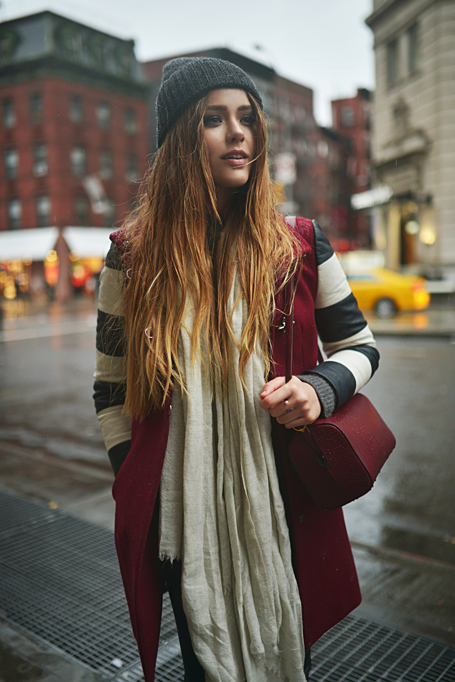 Kristina Bazan is wearing burgundy sleeveless jacket and clutch both from Fay