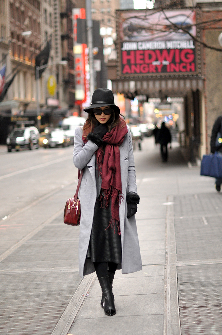 Jessica R. is wearing an oversized burgundy scarf
