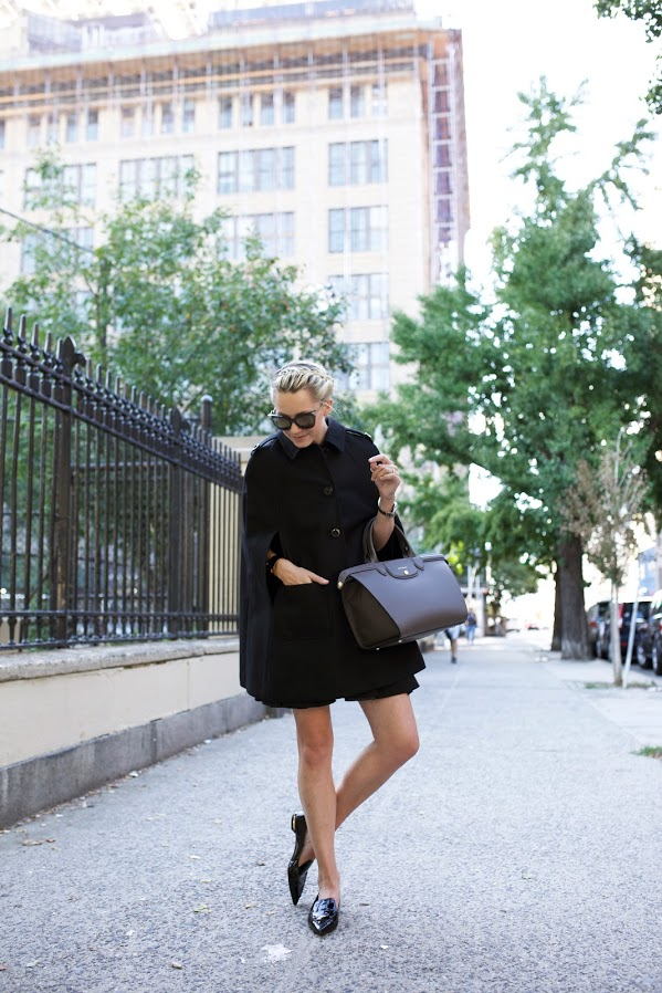 This stylish black cape looks ultra sophisticated combined with black pumps and shades. Via Blair Eadie. Cape: Nordstrom, Bag: Longchamp