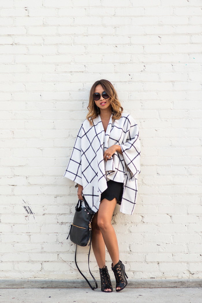 Kim Le wears edgy black heels with her stylish cape. Cape/Camisole: Morning Lavender.