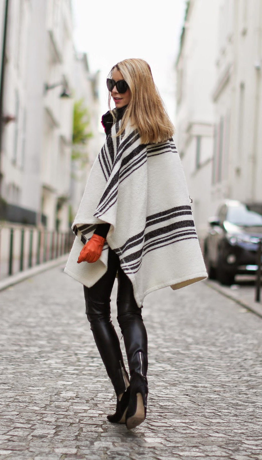 Best Capes Style: Caroline Louis is wearing a black striped white cape from Zara
