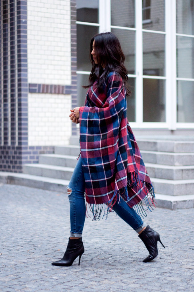 Cape Trend 2015: Kayla Seah is wearing a check wrap cape scarf from Asos
