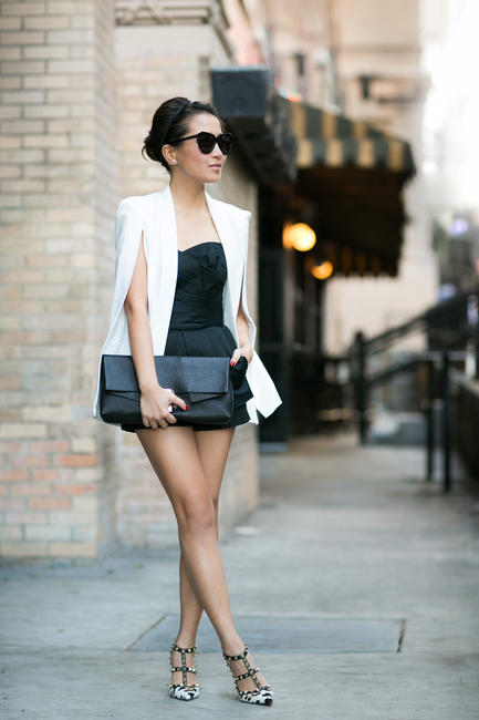 Wendy Nguyen goes with the cape trend wearing a white champagne taste cape blazer from NastyGal