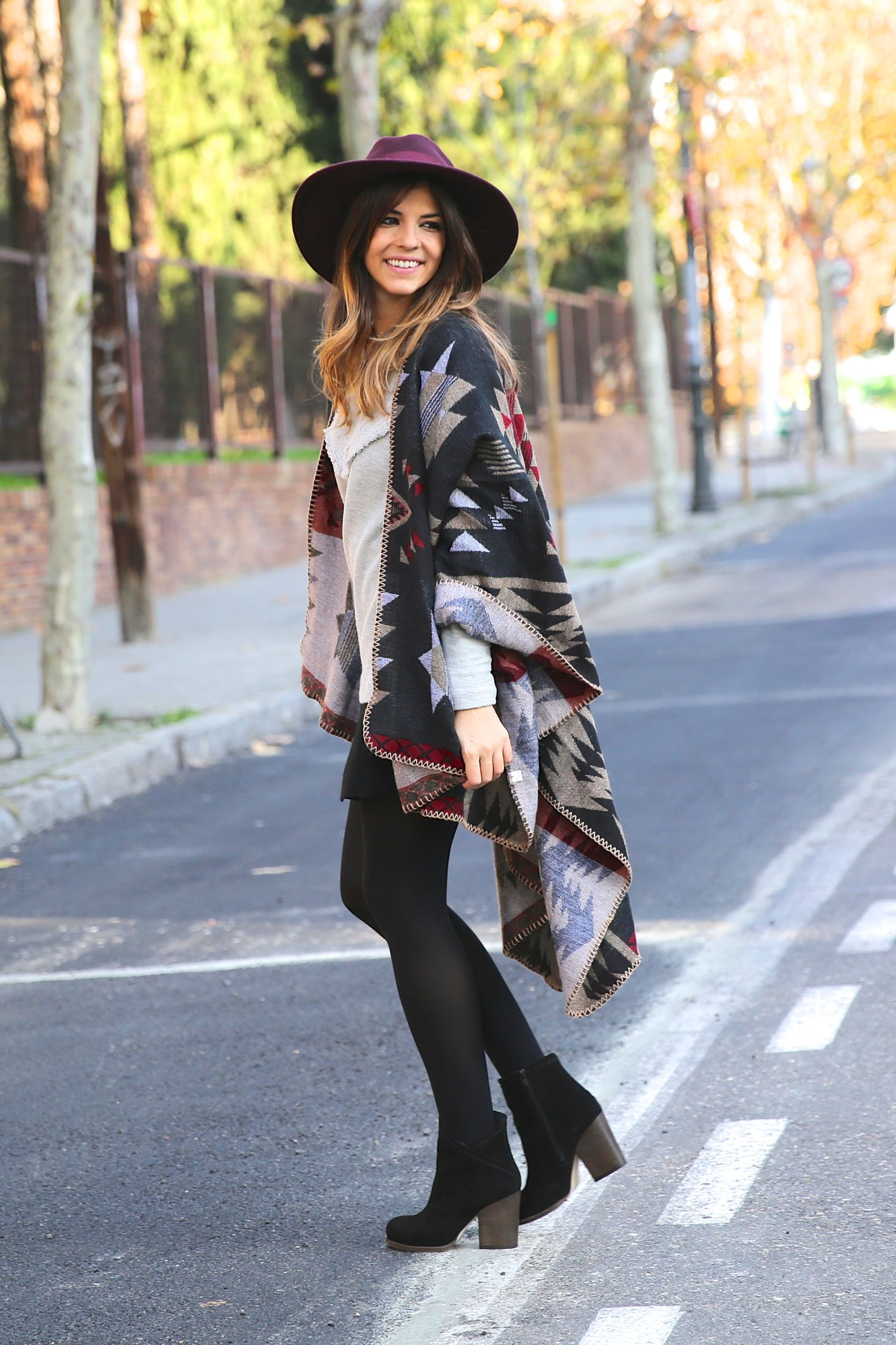 Natalia Cabezas is wearing a ethnic print cape from Simona