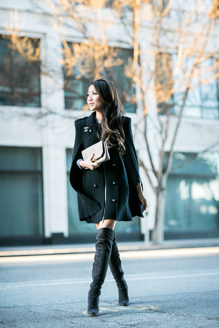 Cape Trend: Wendy Nguyen is wearing a black cape from Pierre Balmain