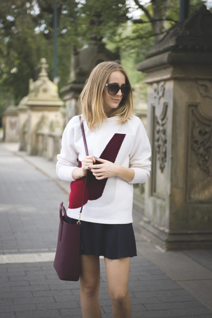 Tiphaine is wearing white, burgyndy and grey colour block top from Lacoste