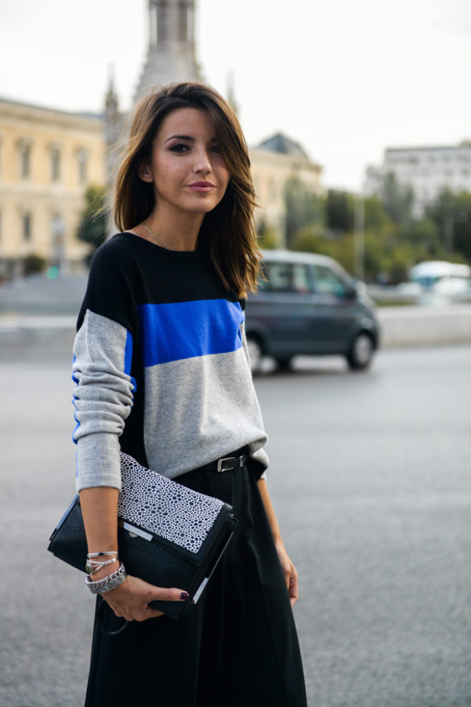 Alexandra Pereira is wearing a black, blue and grey colour break jumper from M&S