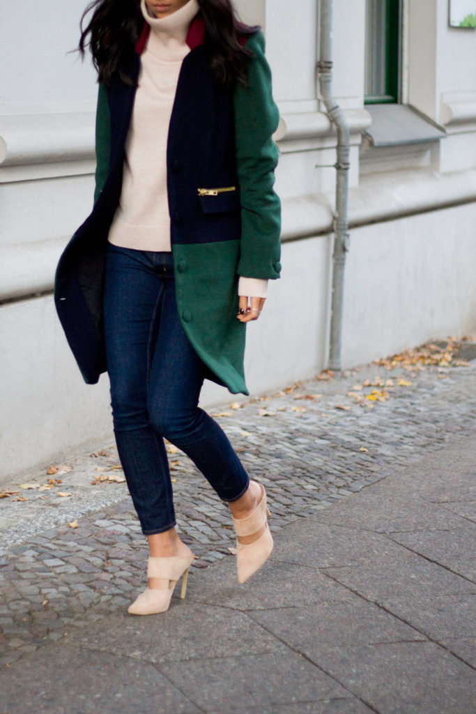 Kayla Seah is wearing a burgundy, green and blue colour block coat from Valentine Pour Vila