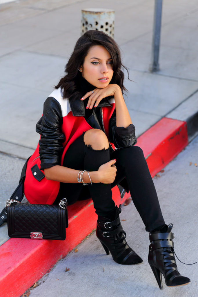 Annabelle Fleur is wearing a red, white and black colour block moto jacket from Express