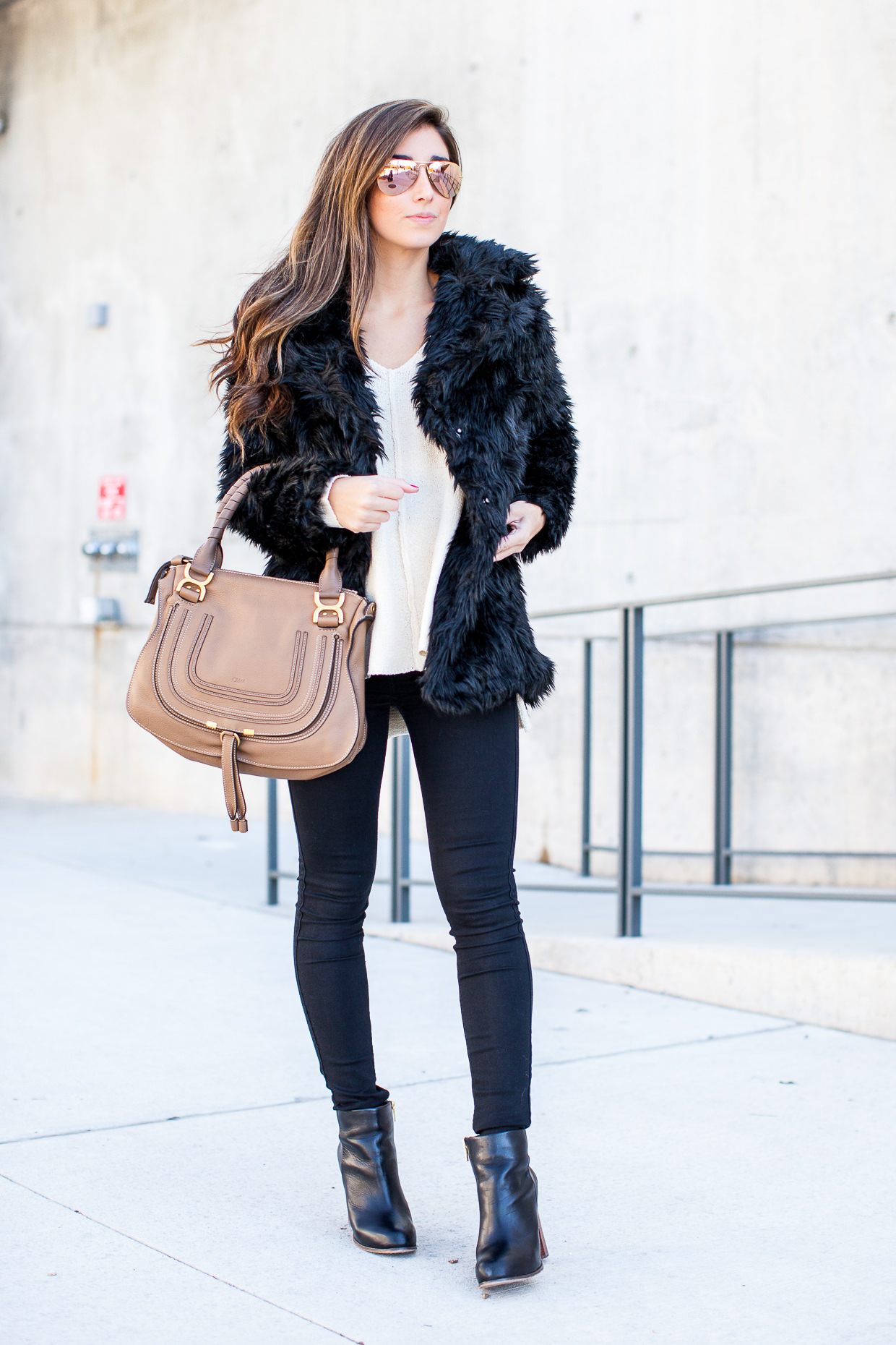 A fluffy coat like this will always afford you a sophisticated style, and will add a glamorous dimension to any outfit! Jessi wears this piece with a simple blouse and jeans. Outfit: Nordstrom.