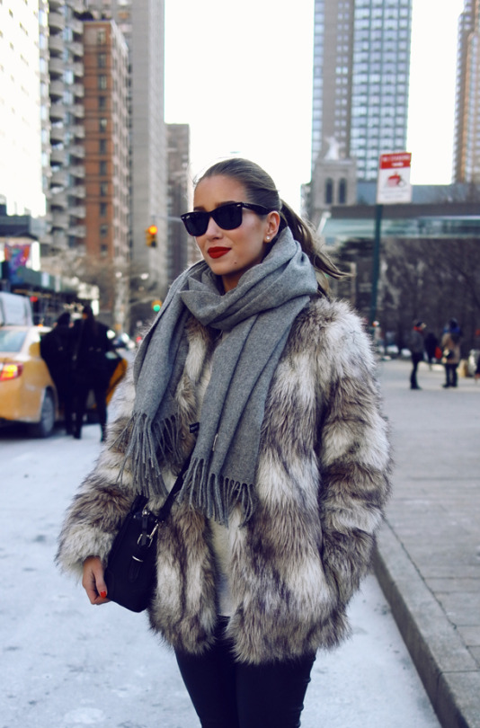 Try a classic faux fur with black jeans and a simple neutral scarf like Emilie Tømmerberg for a glamorous winter style. Throw in a pair of Ray Bans if the weather is good for added style! Brands not specified.