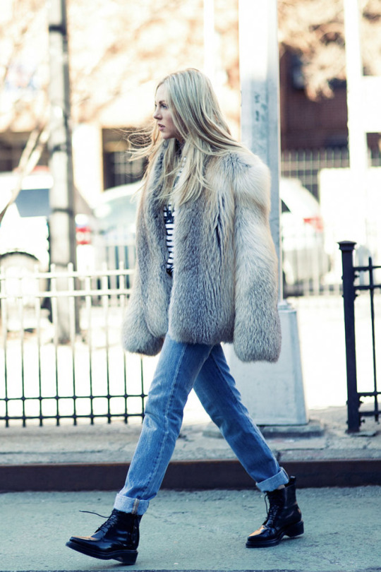 Shea Marie pairs this authentic fluffy faux fur coat with rolled jeans and a pair of edgy combat style boots, affording this look an individual and striking aesthetic. Brands not specified.