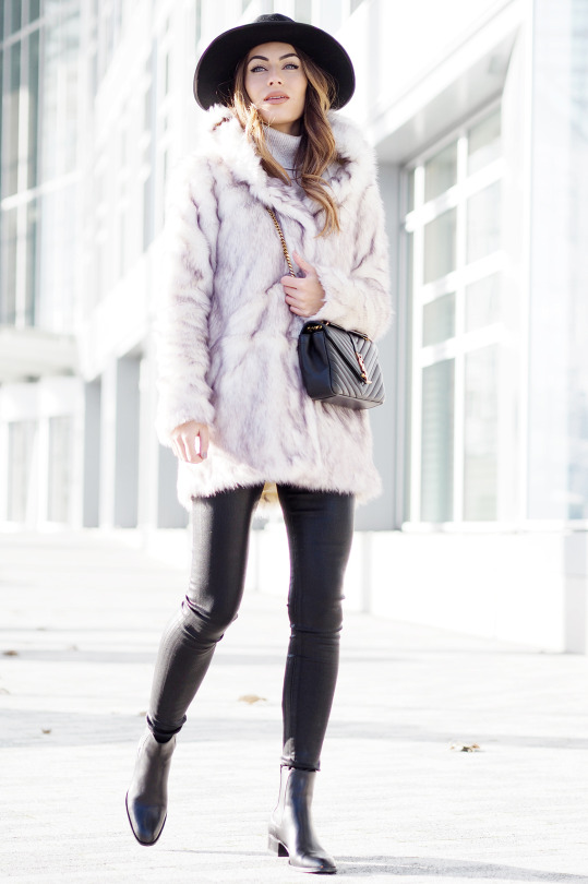 Try wearing a classic white fluffy coat with super skinny jeans to get the edgy, alternative look worn here by Lydia Lise Millen. We also love the hat as a statement accessory to this outfit. Denim: Citizens Of Humanity, Hat: Henri Bendel, Jumper: The White Company, Coat: Boohoo, Boots/Bag: Saint Laurent.
