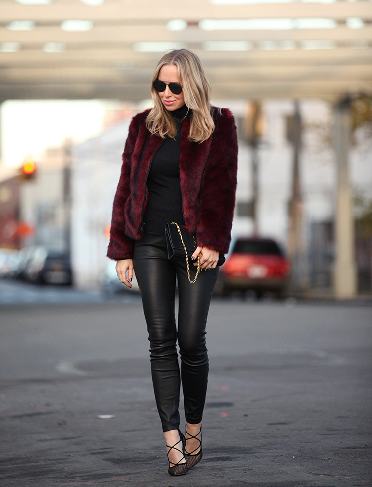 Go wild in a faux fur jacket this fall! Helena Glazer looks ultra stylish in this crimson coat from Express Edition; try wearing a fluffy coat with leather to get this edgy look. Jacket/Leggings: Express Edition, Turtleneck: Vince, Shoes: Gianvito Rossi, Bag: Saint Laurent.