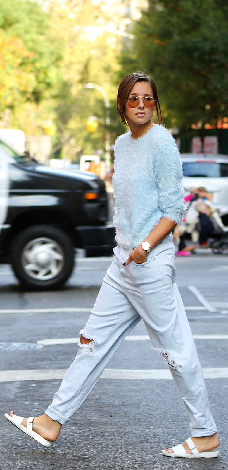 Danielle Bernstein is wearing a blue fluffy sweater from TopShop, ripped jeans and the sandals are from Vagabond
