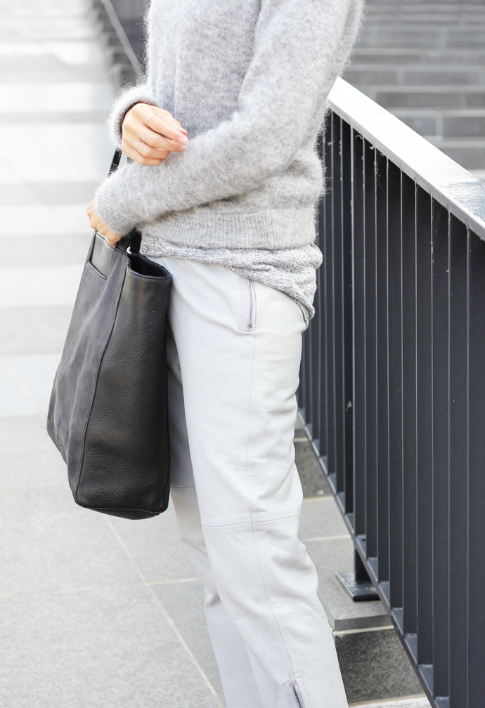 Joyce Croonen is wearing a fluffy knit grey sweater from Acne and the trousers are from Humanoid