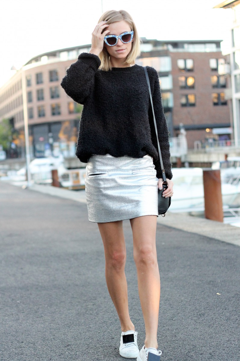 Tine Andrea is wearing a silver skirt and fuzzy sweater from Nelly, shoes from Acne, the bag is from Givenchy and the sunglasses are from Asos