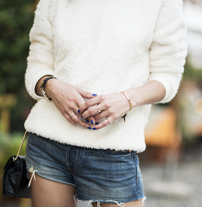 Anouska Proetta Branson is wearing a fuzzy jumper from Tally Weijl, denim cut offs from Levis and a bag from Milly