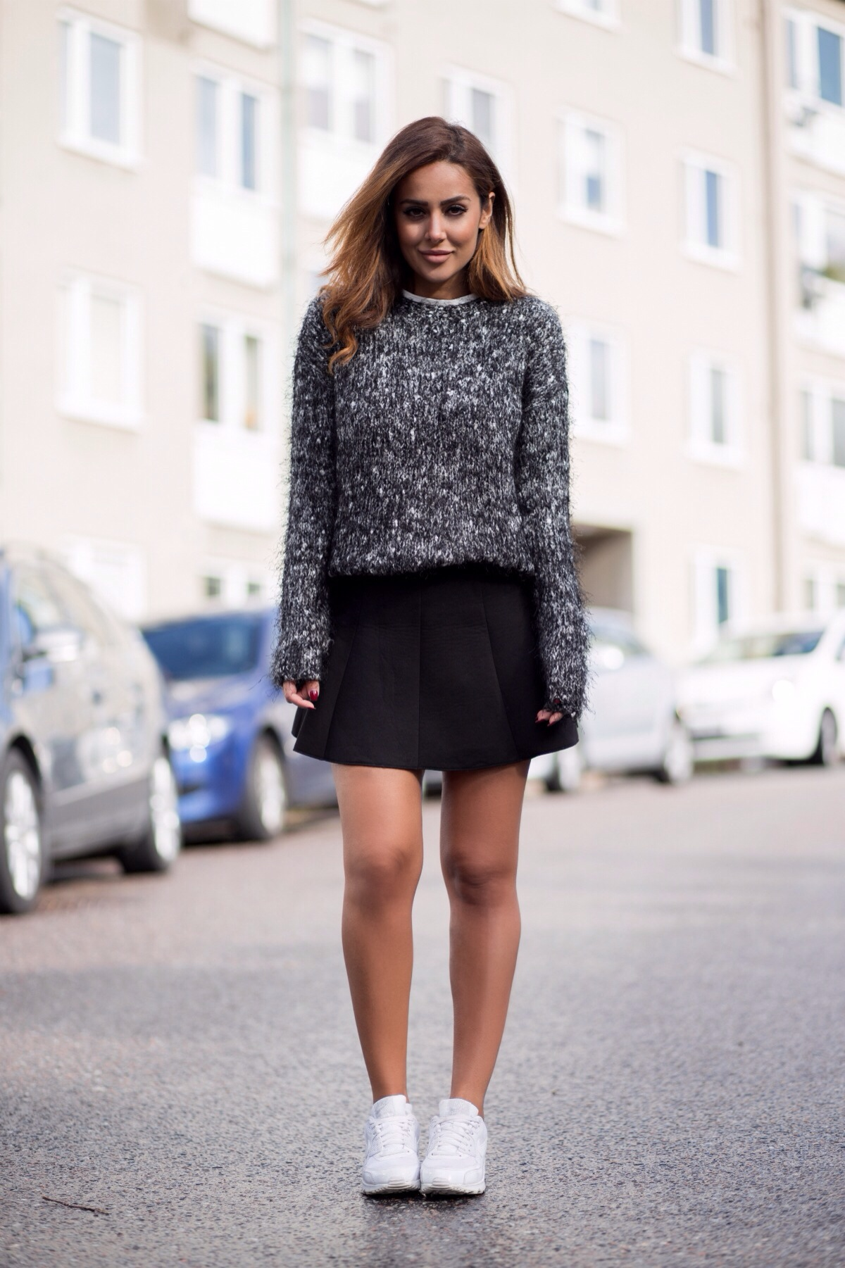 Sharareh Sophia Hosseini is wearing a black and white fluffy jumper from BikBok