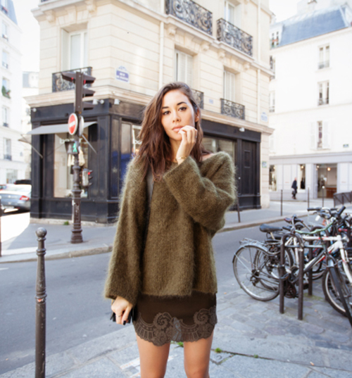 Rumi Neeley is wearing a mohair Khakhi fuzzy sweater with back tie from Zara