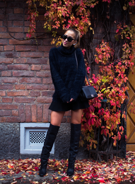 Kenza Zouiten is wearing a fuzzy black sweater from IvyRevel