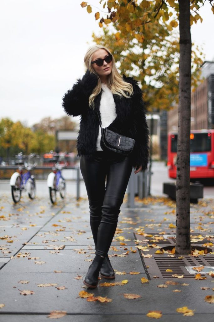 Marie Wolla is wearing a black fluffy jacket from NLY Trend