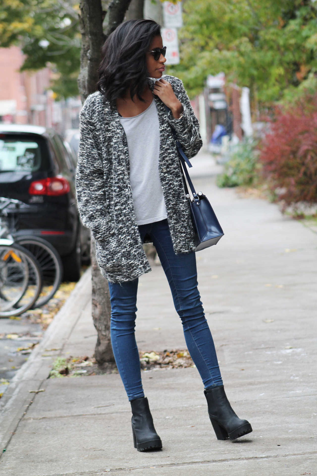 Lama from Babes In Velvet is wearing a grey textured cardigan from Thrifted