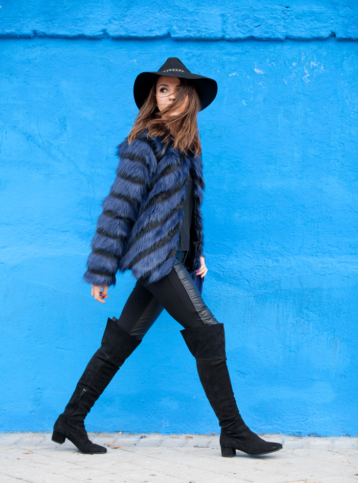 Alexandra Pereira is wearing a blue and black fluffy faux fur coat from Fairly