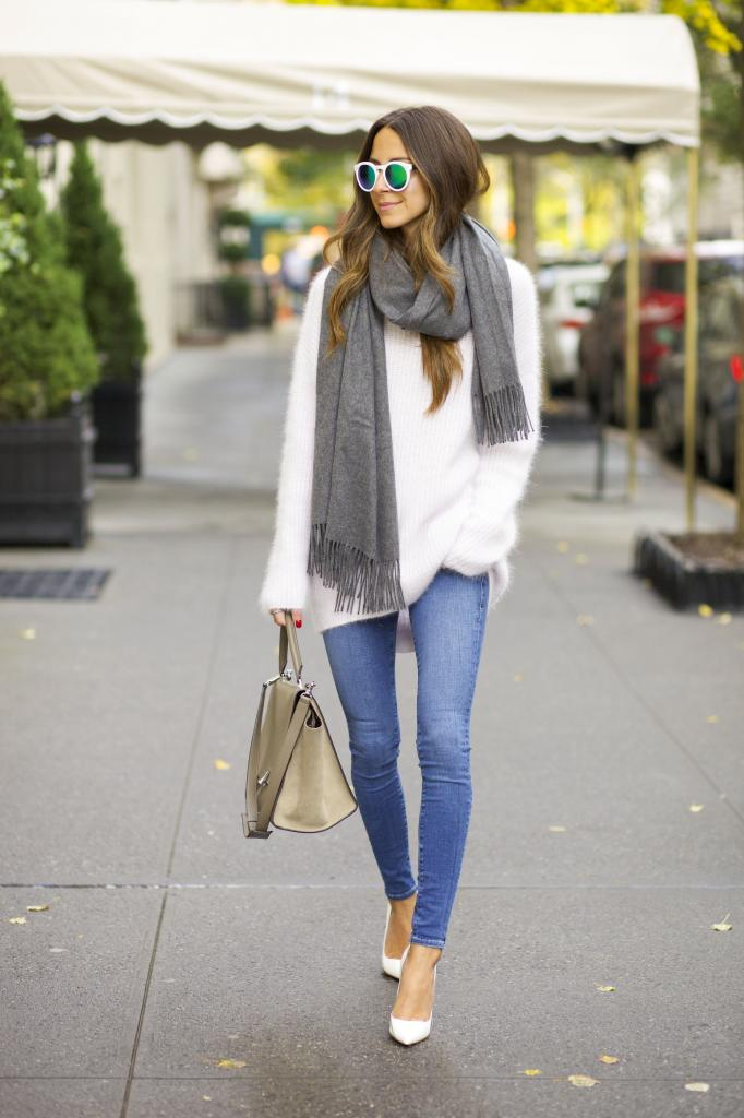 Arielle Nachami is wearing a white fuzzy sweater from Intermix