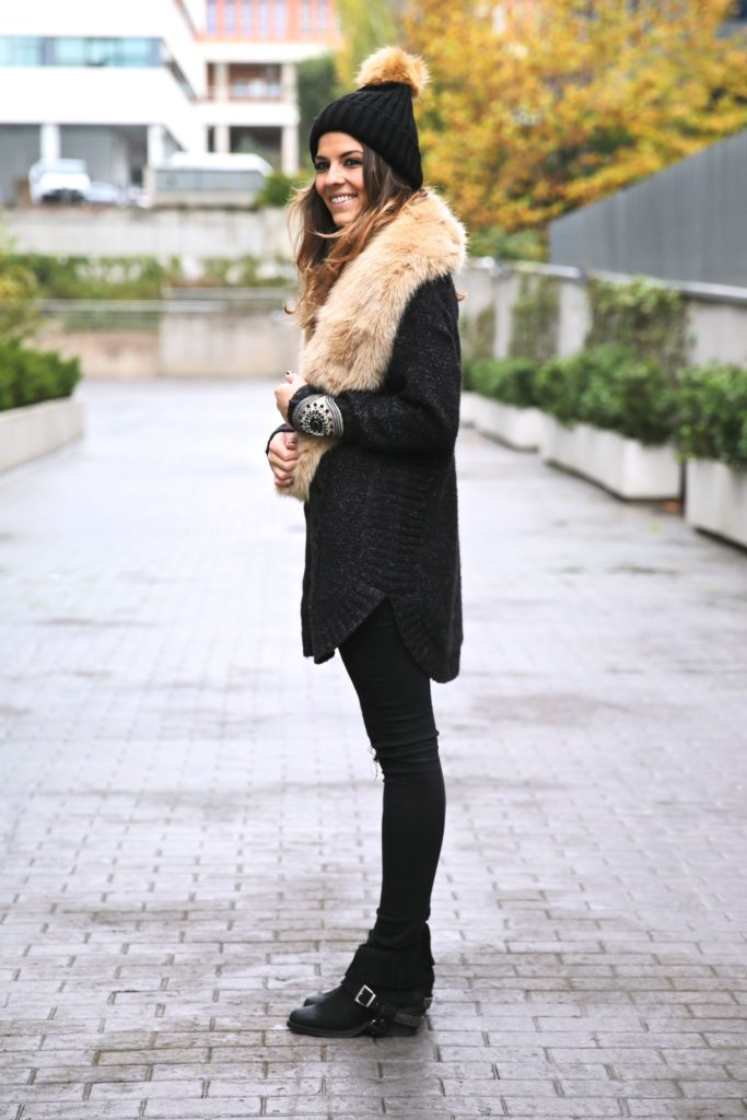 Natalia Cabezas is wearing a heavy knit sweater, fluffy hat and scarf from Zara