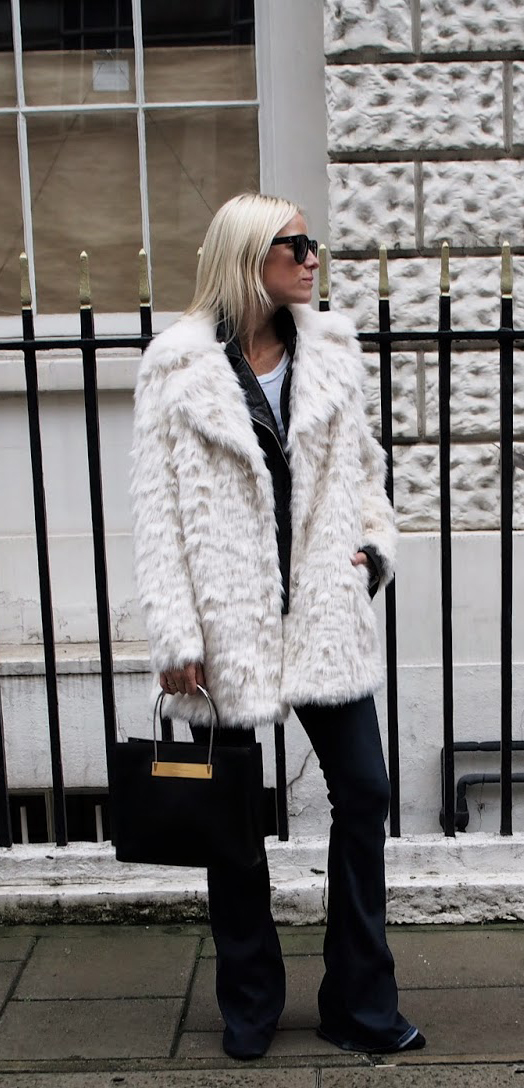 Celine Aagaard is wearing a white faux fur coat from TopShop