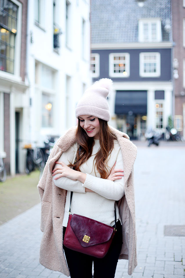 Olivia Purvis is wearing a fluffy pink coat from Free People