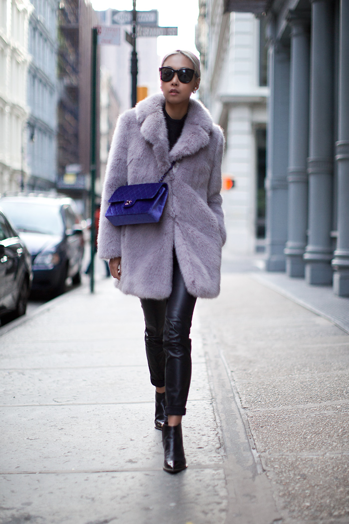 Vanessa Hong is wearing a purple fluffy faux fur coat from Whistles