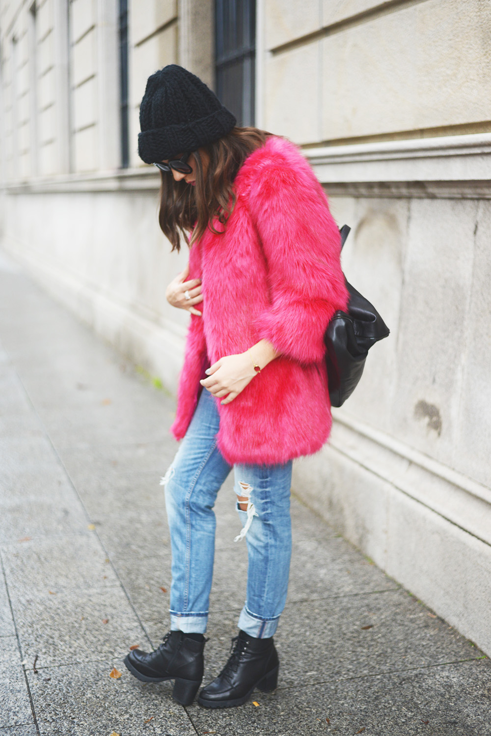 Carla Estévez Marcos is wearing a pink faux fur fluffy coat from Madrid Store
