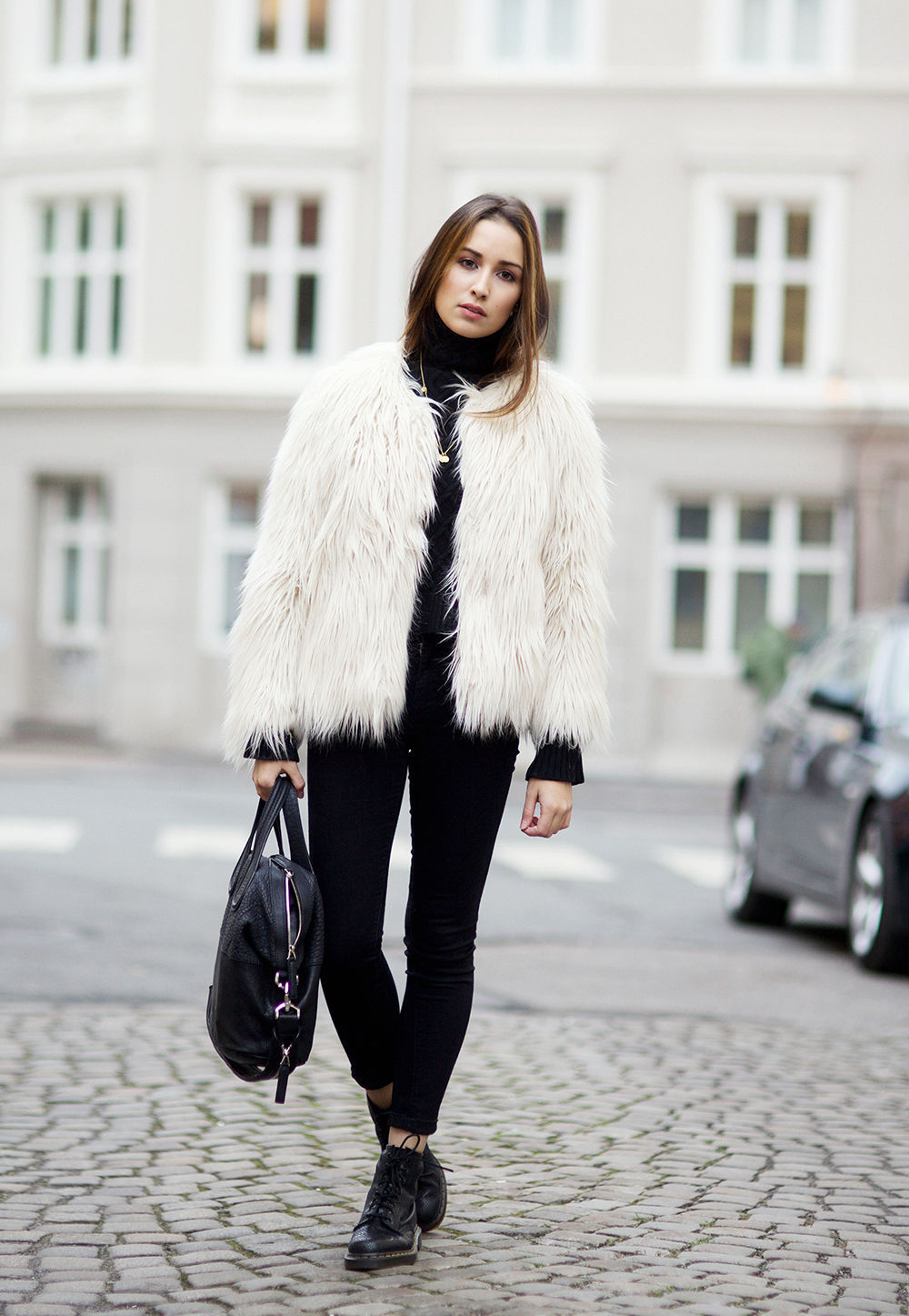 Ingrid Holm is wearing a white shaggy jacket from Lindex