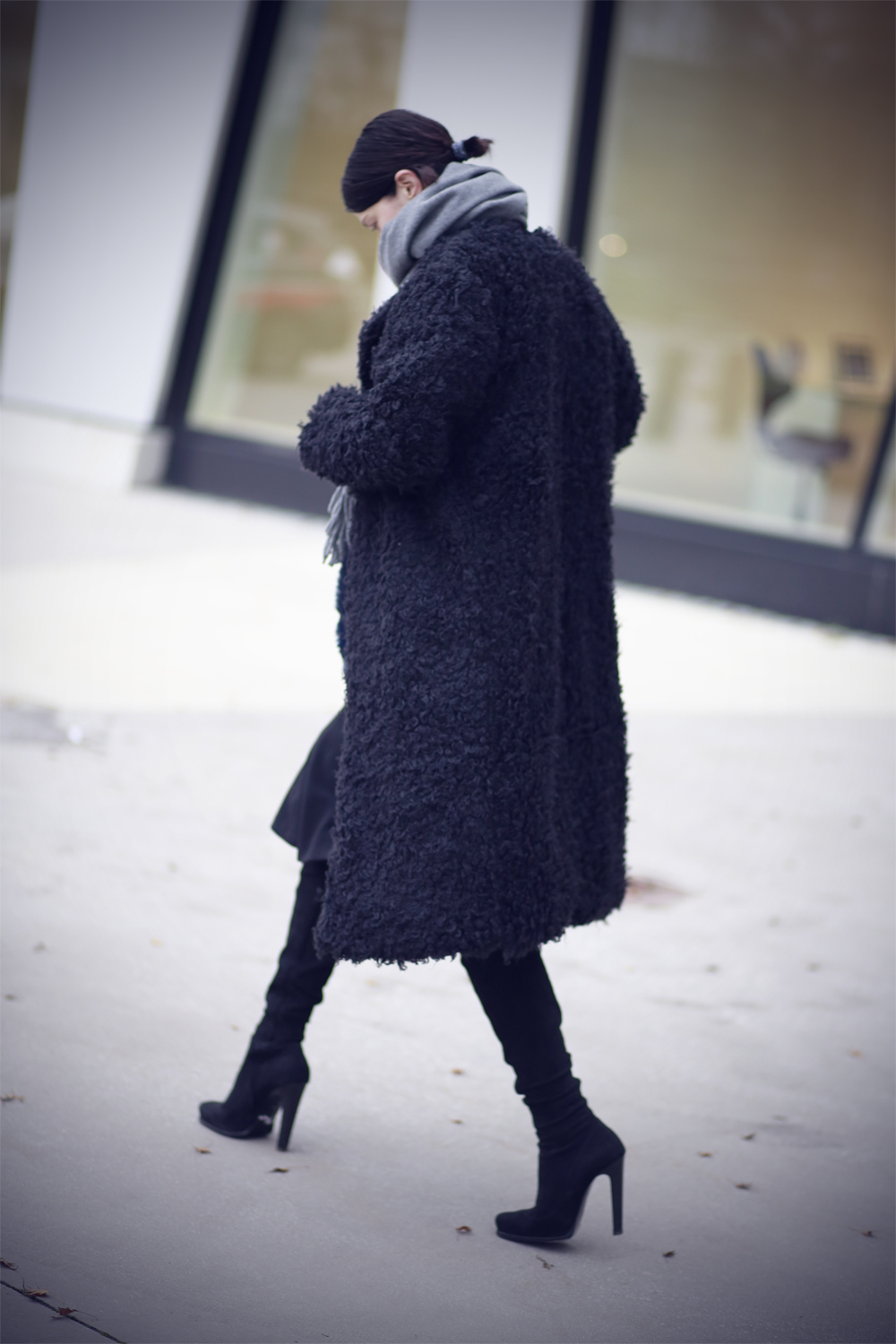 Marianne Theodorsen is wearing a long black fluffy coat from Line of Oslo