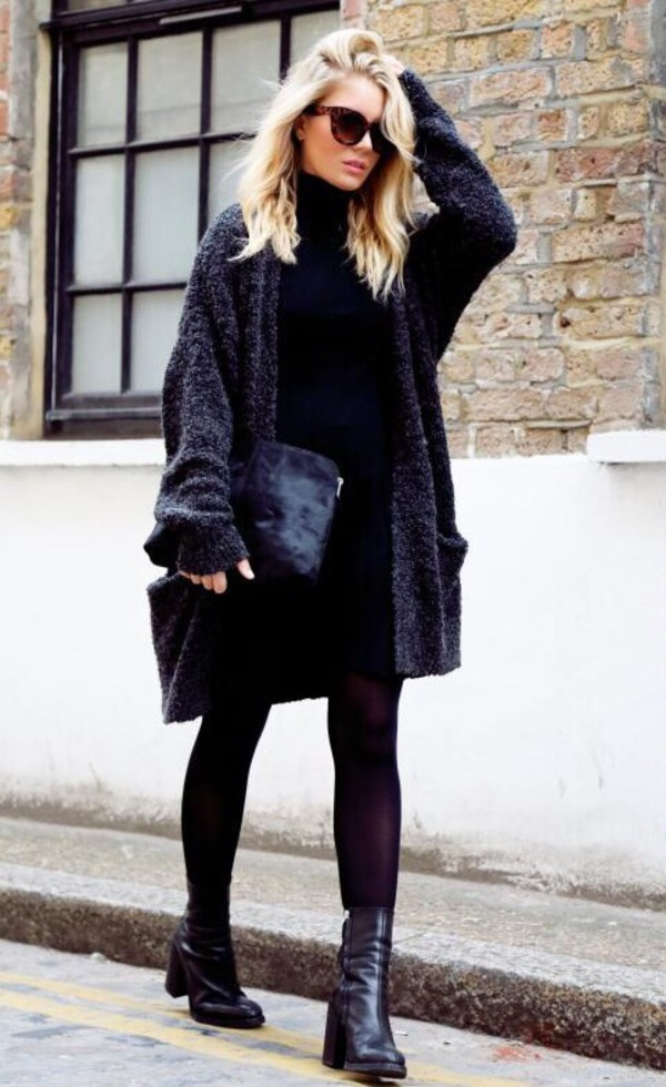Isabella Thordsen is wearing an oversized fuzzy cardigan from Envii and the shoes, dress and clutch are from Asos