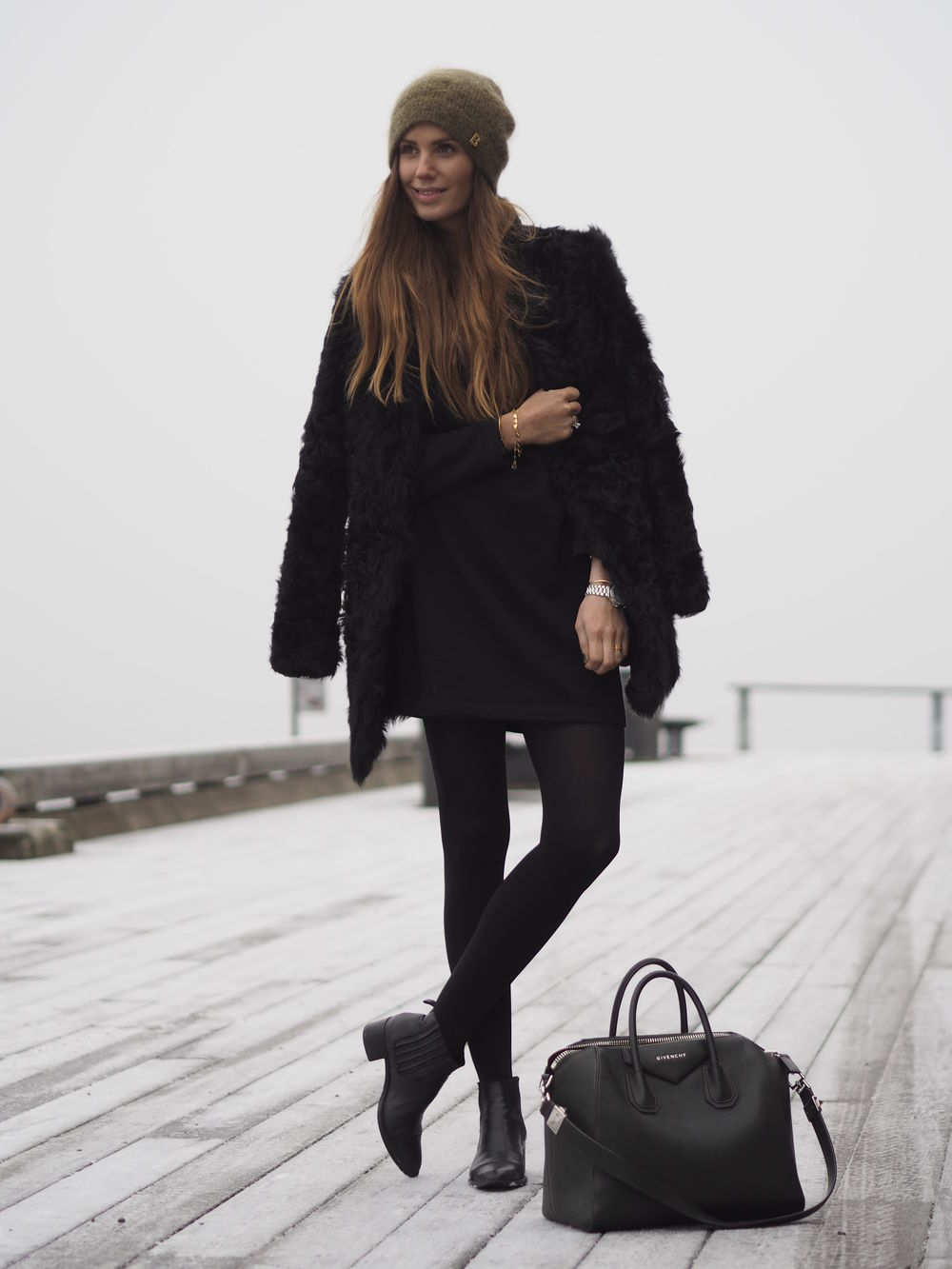 Fluffy Coats For Winter: Benedichte is wearing a black fluffy coat from V Collection