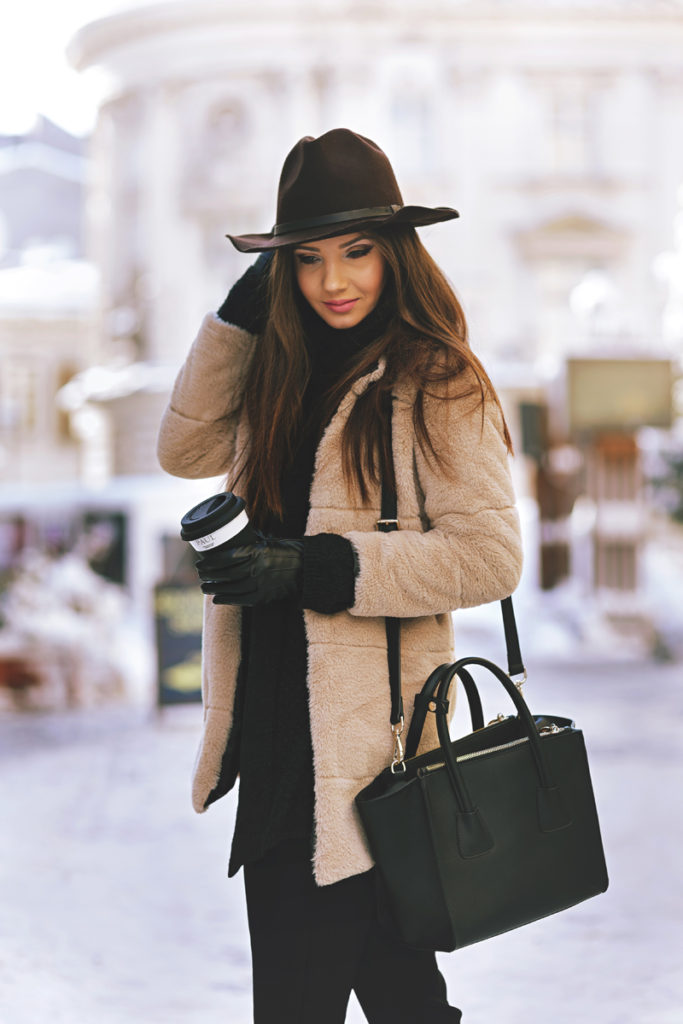 Fluffy Coat Trend: Larisa Costea is wearing a Khaki faux fur coat from Sheinside