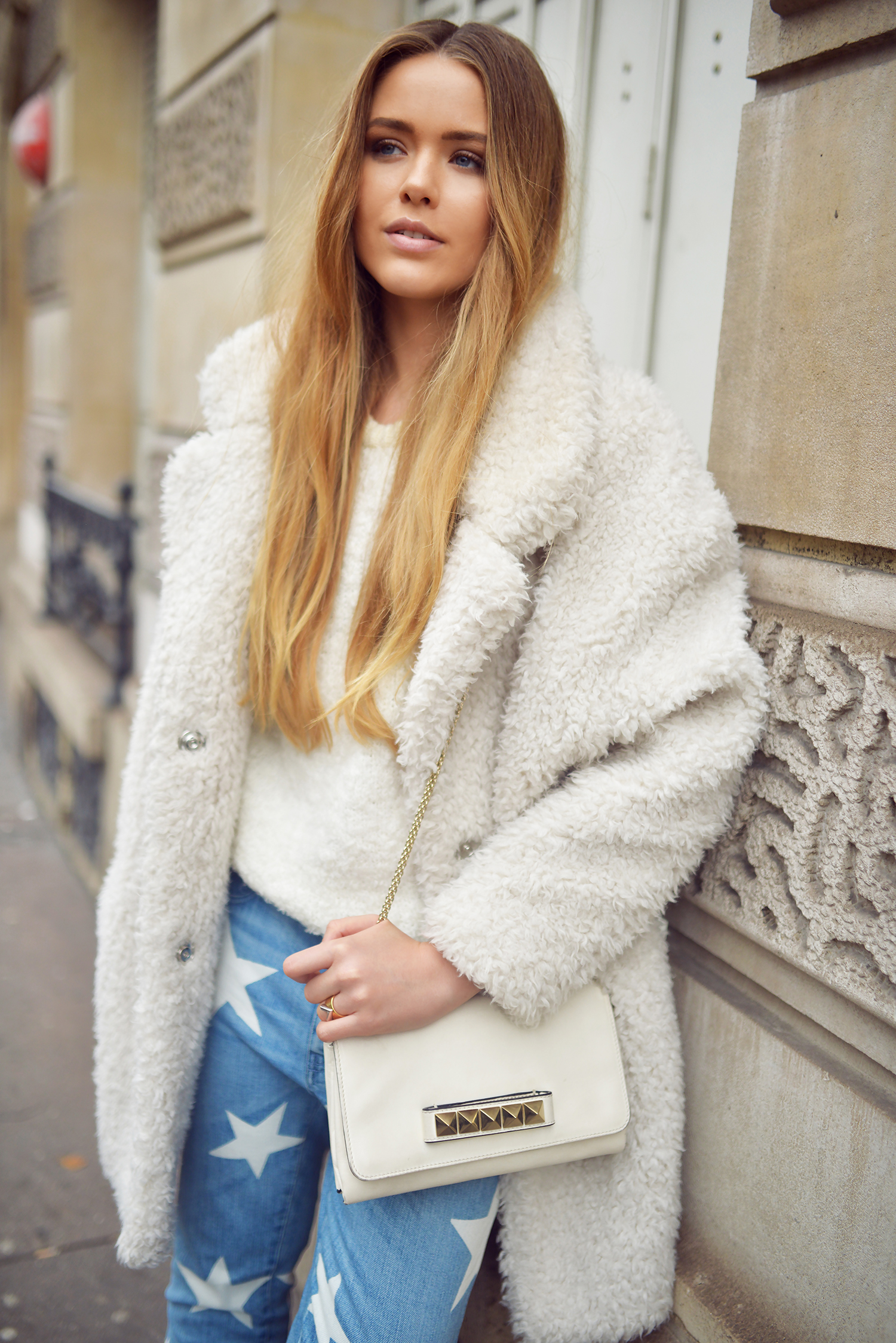 Kristina Bazan is wearing a fluffy white coat from Gérard Darel