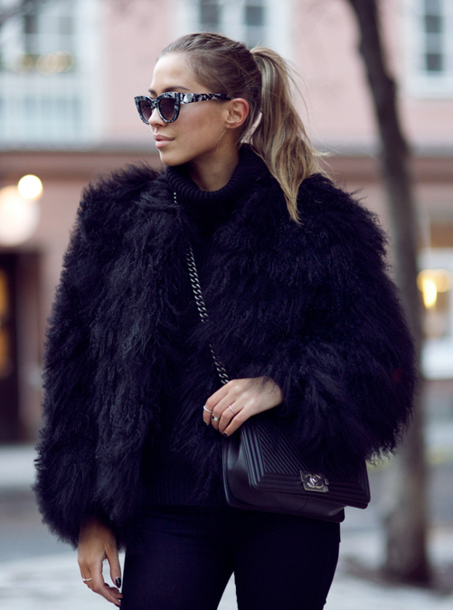 Kenza Zouiten is wearing a black fluffy faux fur jacket from Pello Bello