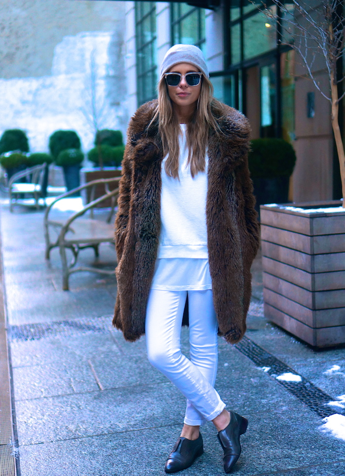 Winter Fur Coat: The Pearl Oyster is wearing a faux fur coat from Zara