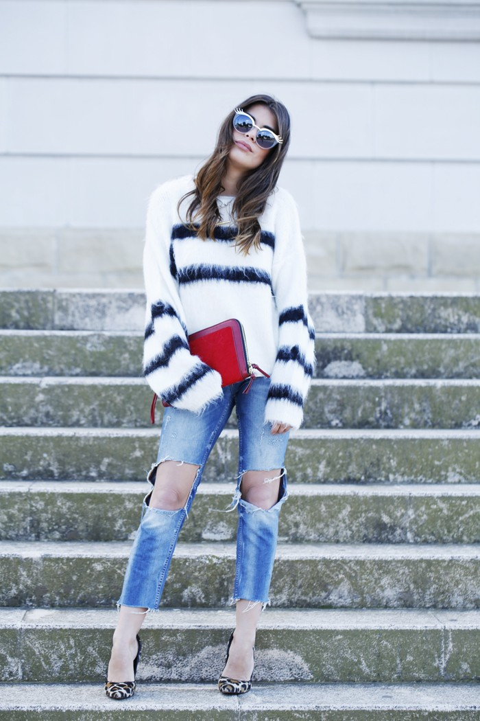 Aida Domenech is wearing a fluffy oversized black and white striped sweater from H&M