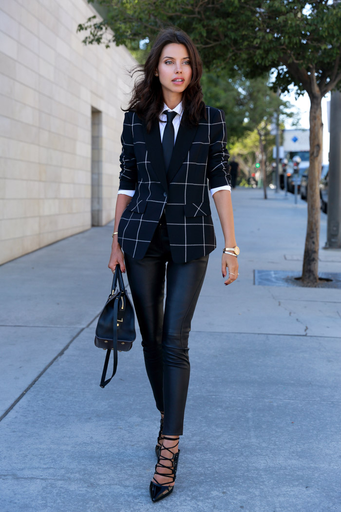 Annabelle Fleur is wearing a dark blue and white stripe big grid blazer from State